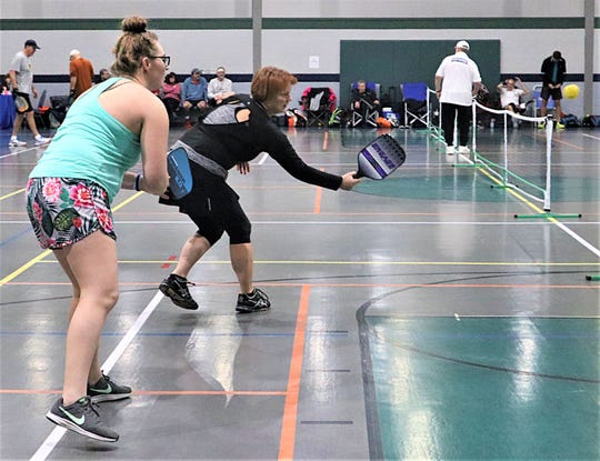 Celeste Bittner (blue, front) and Kathy Demetri (black) competed in Saturday's Pickleball tournament at Kids America.