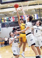 Ankeny junior Braxton Bayless (15) shoots over the tough defense as the Ankeny Hawks compete against the Ankeny Centennial Jaguars in high school boys basketball on Friday, Jan. 11, 2019, at Ankeny Centennial High School. Ankeny won 61 to 51.
