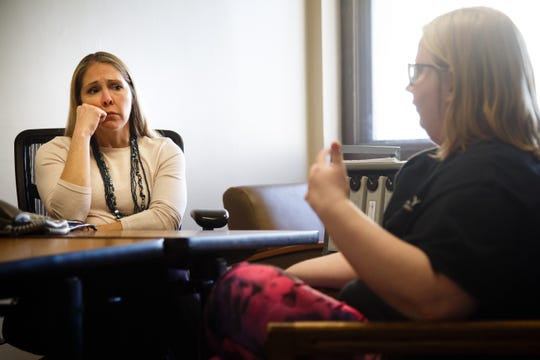 Carroll resident Caitlin Main, right, talks to psychiatrist Amy Canuso about voices she hears in her head at St. Anthony Regional Hospital on Tuesday, Dec. 18, 2018, in Carroll.