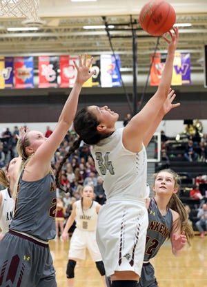Ankeny Centennial junior Alexandria Keahna-Harris (34) attempts the reverse lay-up as the Ankeny Hawkettes compete against the Ankeny Centennial Jaguars in high school girls basketball on Friday, Jan. 11, 2019, at Ankeny Centennial High School.
