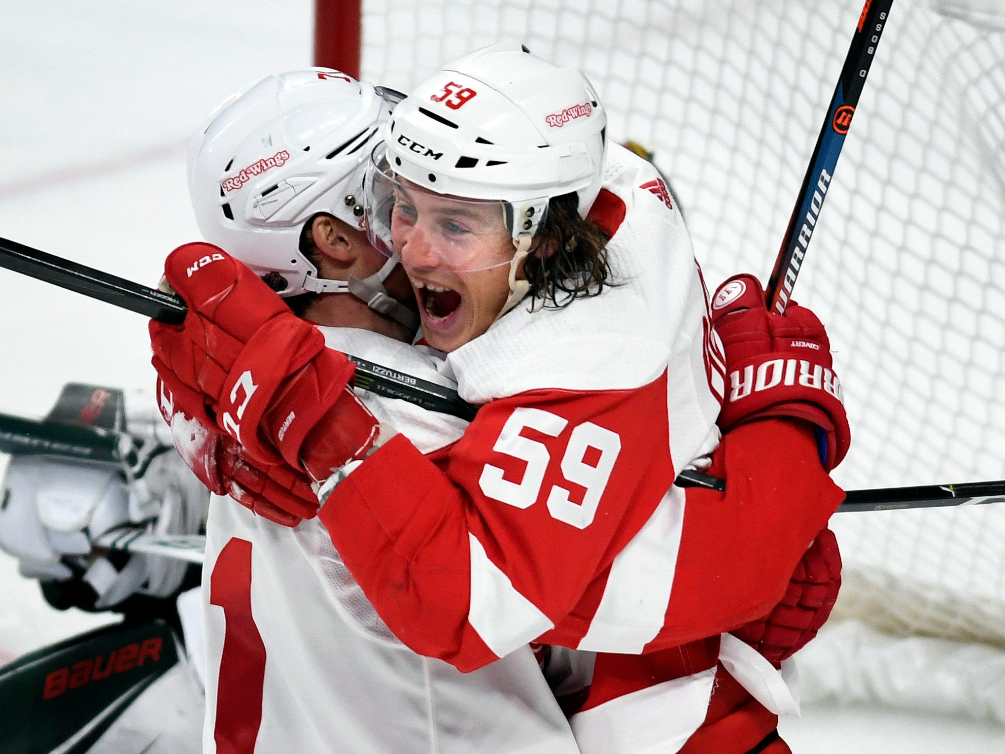 Red Wings forward Dylan Larkin, left, hugs Tyler Bertuzzi after he scored his hat trick during the third period of the Wings' 5-2 win on Saturday, Jan. 12, 2019, in St. Paul, Minn.