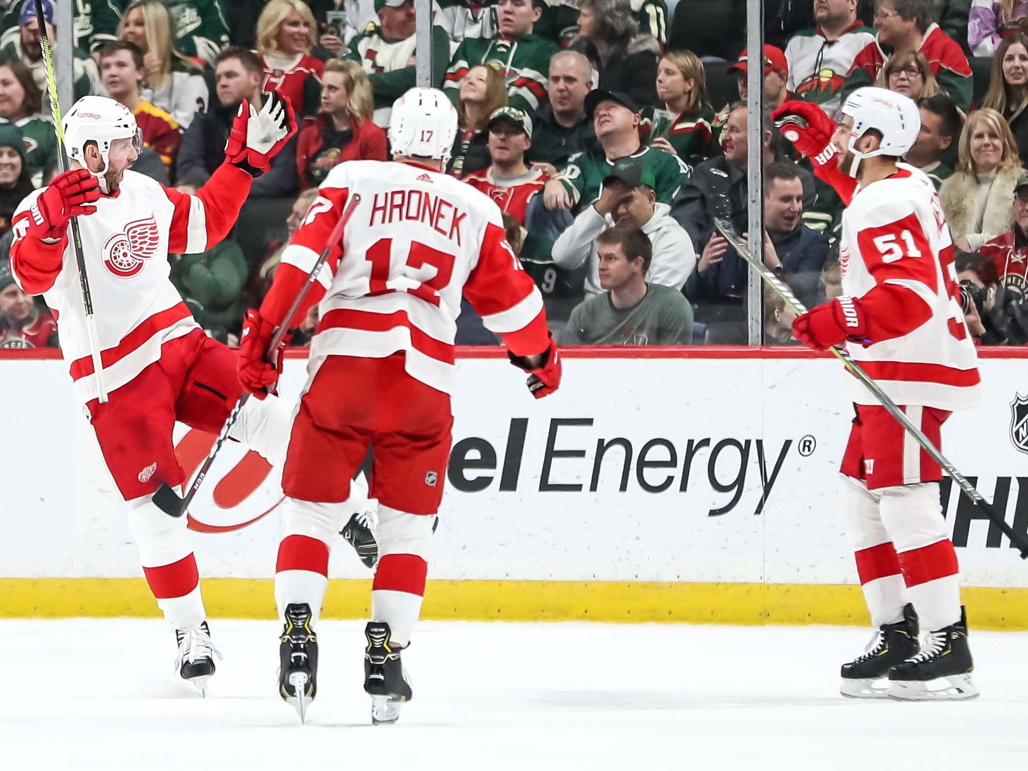 Red Wings forward Thomas Vanek, left, celebrates his goal with teammates during the second period of the Wings' 5-2 win on Saturday, Jan. 12, 2019, in St. Paul, Minn.