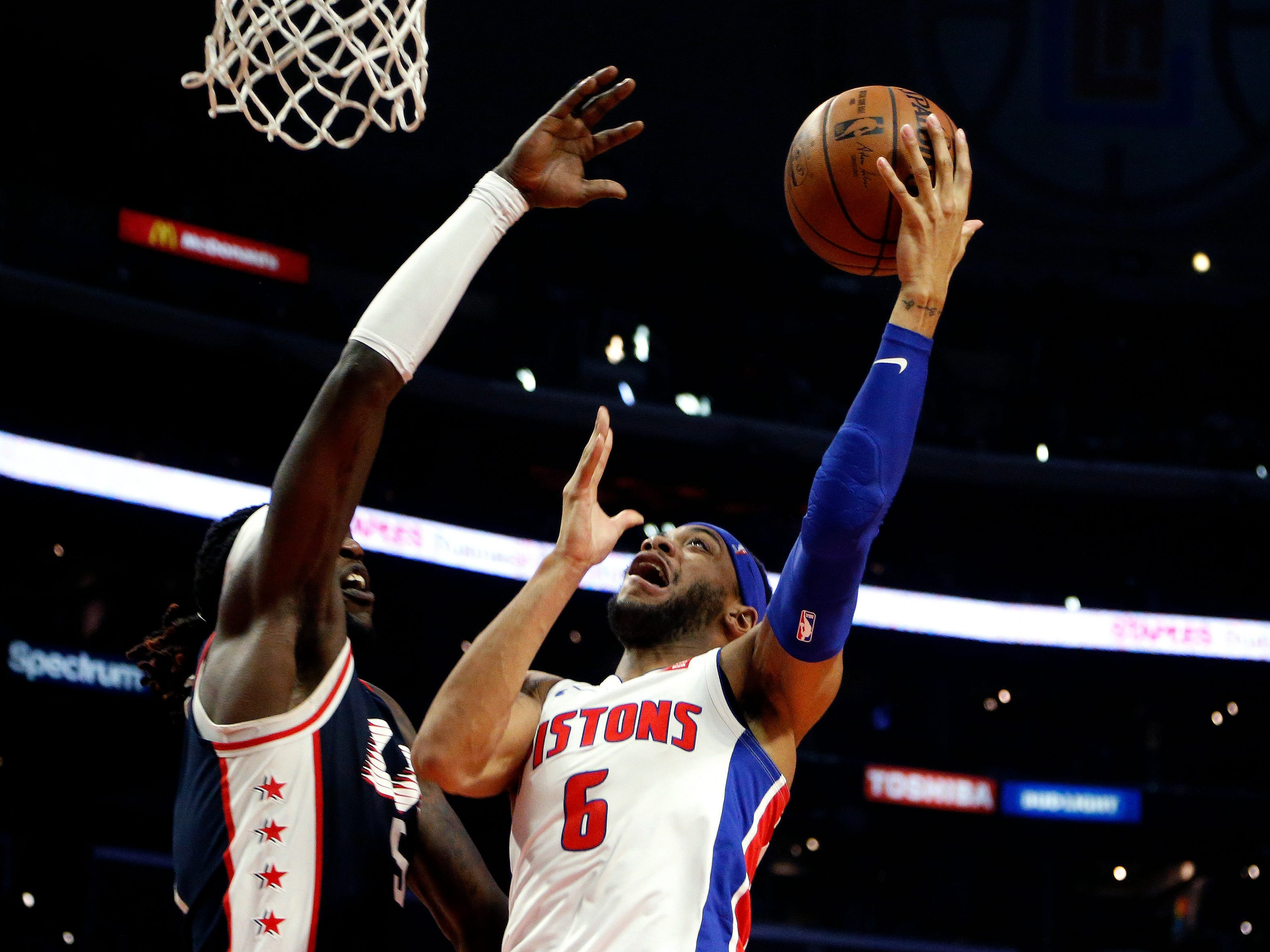 Detroit Pistons' Bruce Brown is defended by Los Angeles Clippers' Montrezl Harrell in the second half Saturday, Jan. 12, 2019, in Los Angeles.