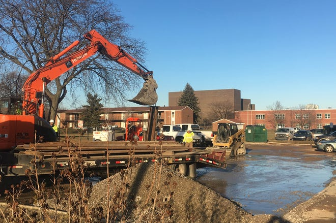 Crews work to repair a broken water main near Larned and McDougall in Detroit on Sunday, January 13, 2018.