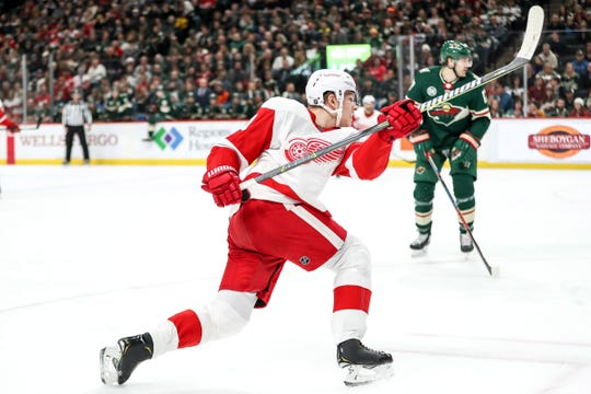 Detroit Red Wings defenseman Dennis Cholowski shoots during the first period against the Minnesota Wild at Xcel Energy Center, Saturday, Jan. 12, 2019, in St. Paul, Minn.