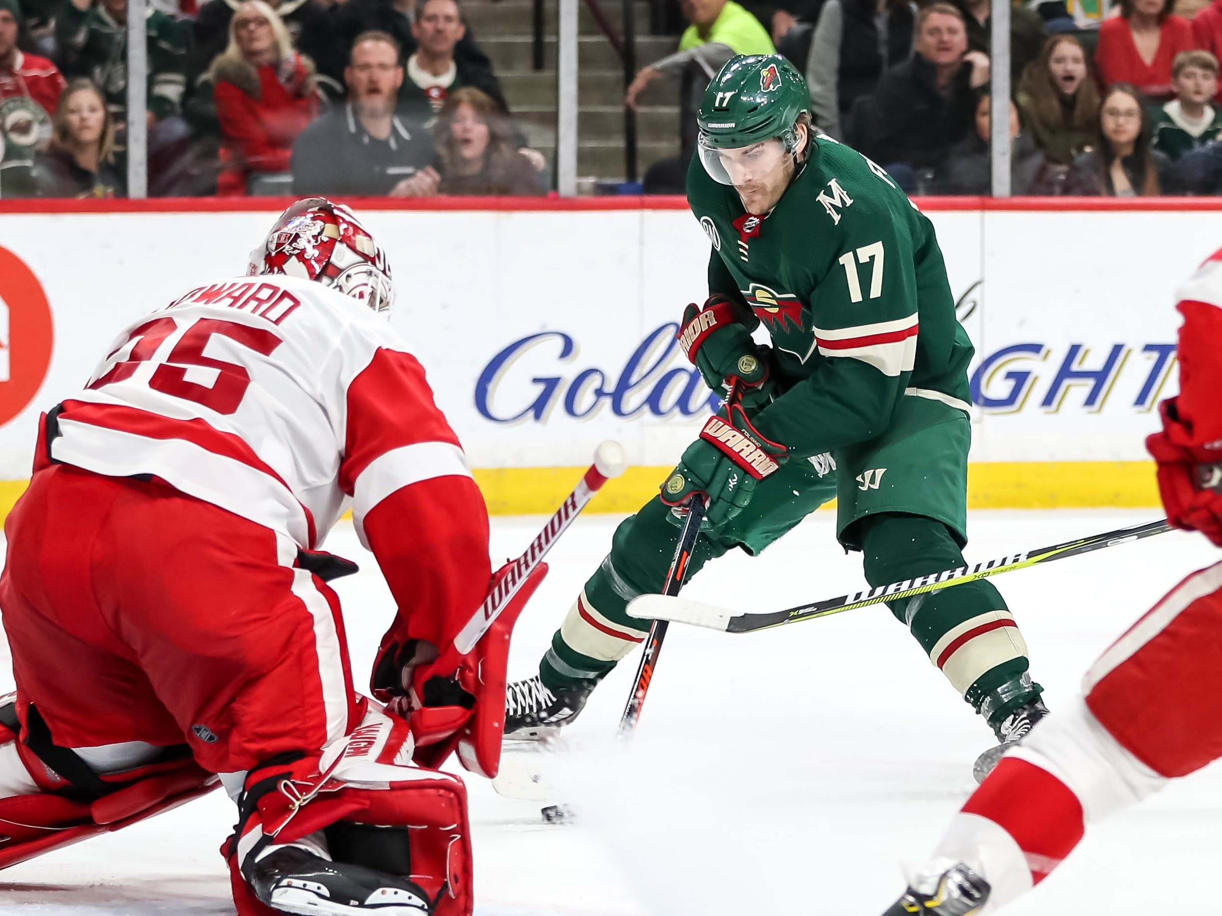 Minnesota Wild forward Marcus Foligno shoots on Detroit Red Wings goalie Jimmy Howard during the second period Jan. 12, 2019 in Saint Paul, Minn.