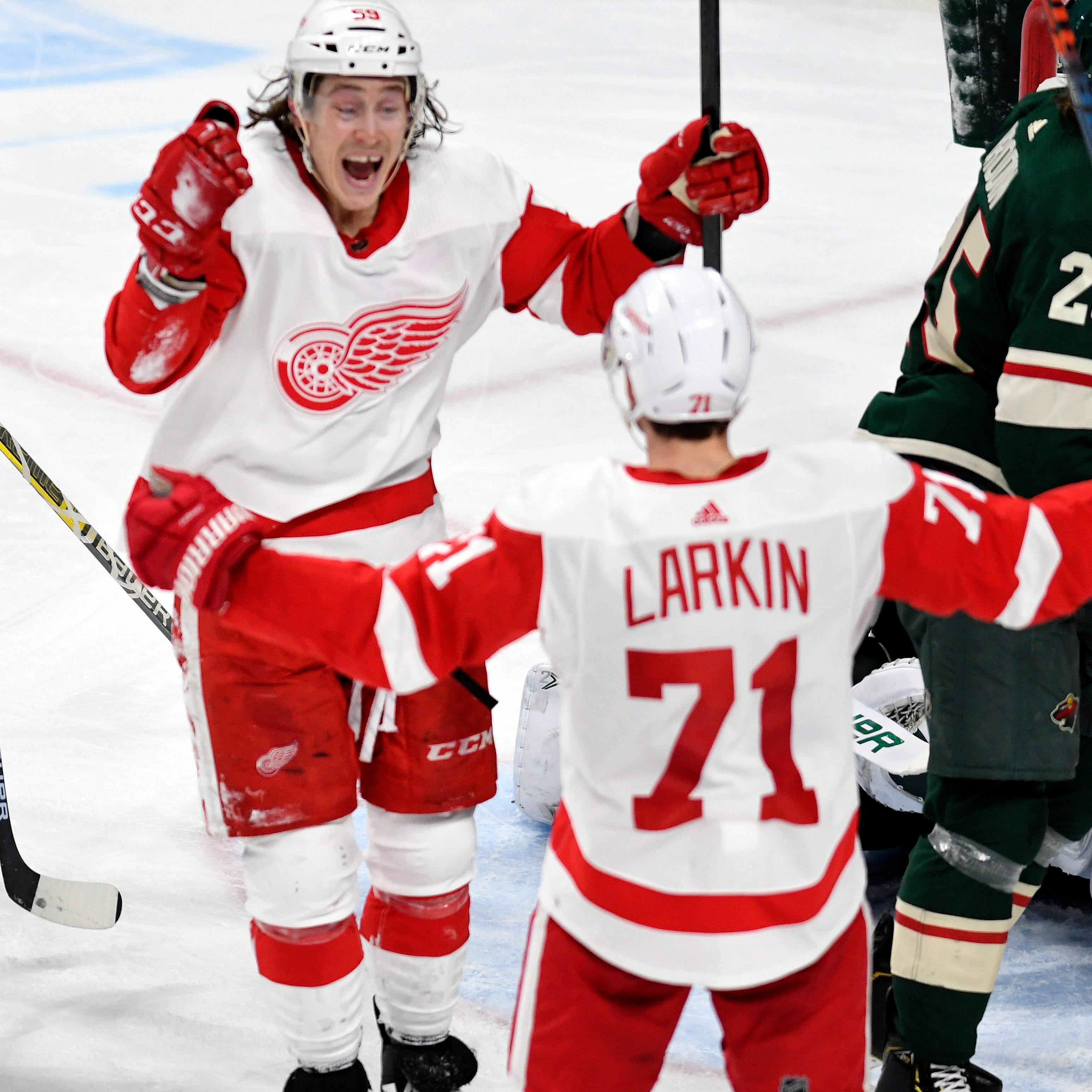 Red Wings forward Dylan Larkin, right, celebrates...