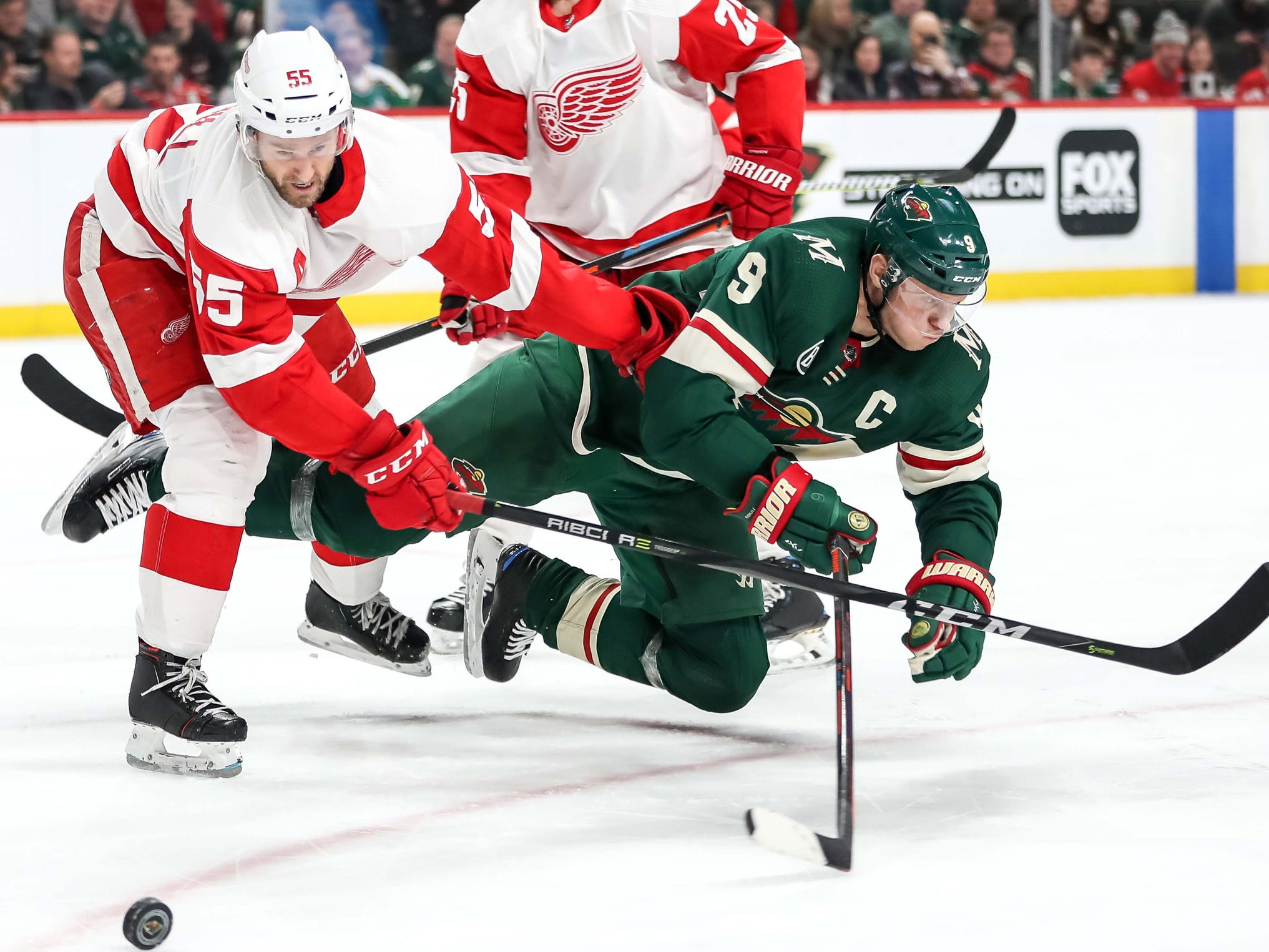 Red Wings defenseman Niklas Kronwall hits Wild forward Mikko Koivu during the second period of the Wings' 5-2 win on Saturday, Jan. 12, 2019, in St. Paul, Minn.
