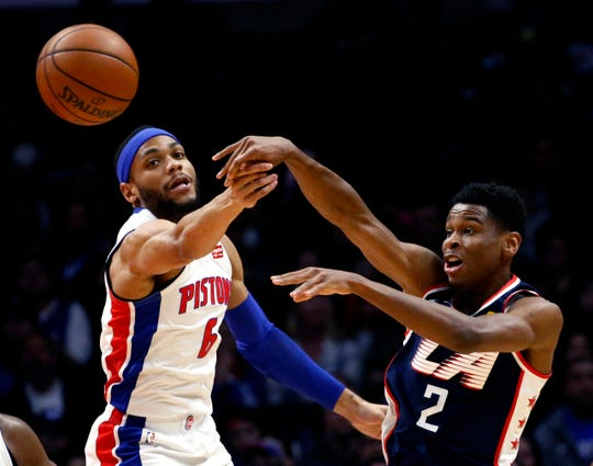 Clippers' Shai Gilgeous-Alexander passes against Pistons' Bruce Brown during the second half Saturday.