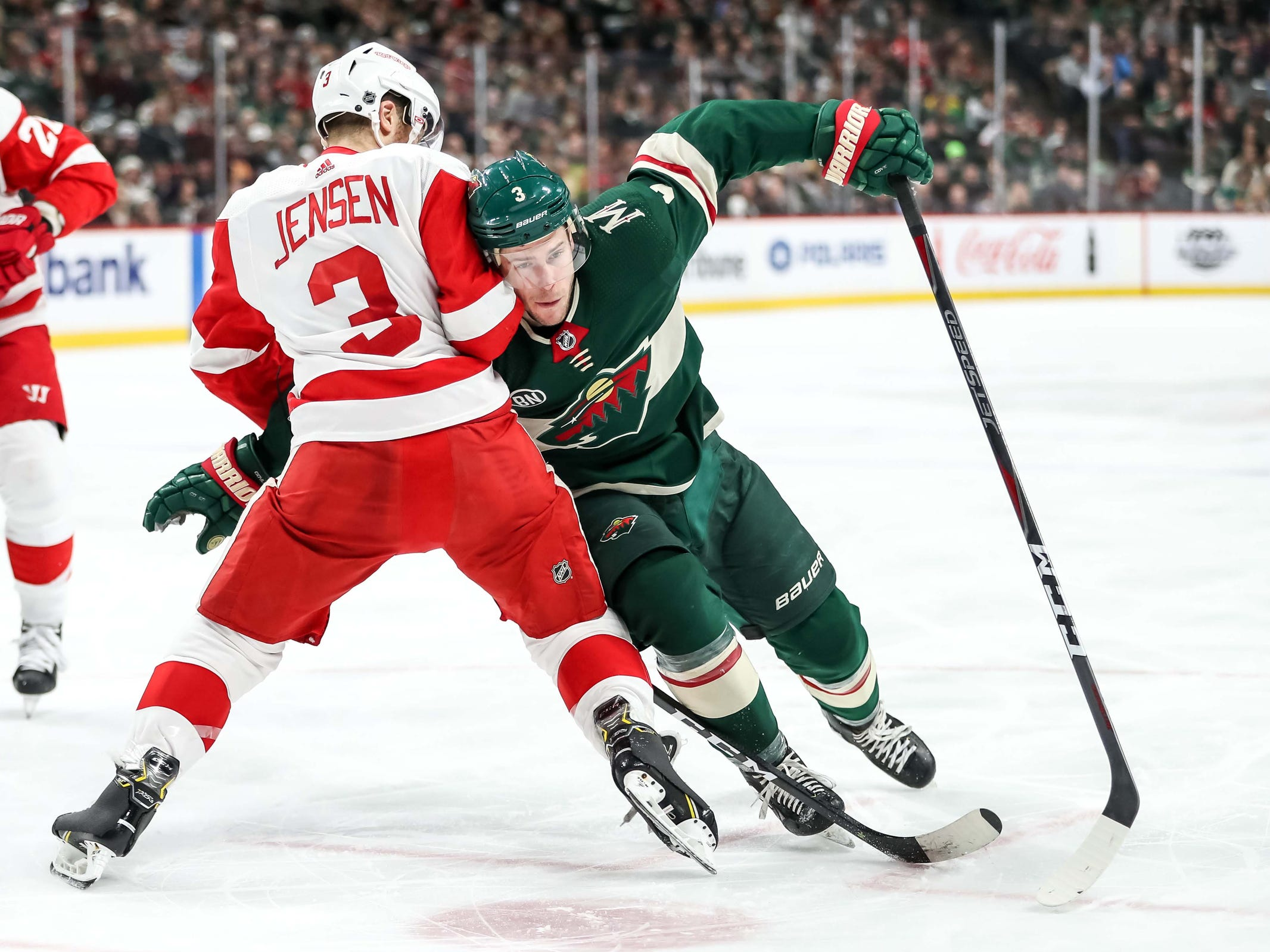 Detroit Red Wings defenseman Nick Jensen defends Minnesota Wild forward Charlie Coyle during the second period Jan. 12, 2019 in Saint Paul, Minn.