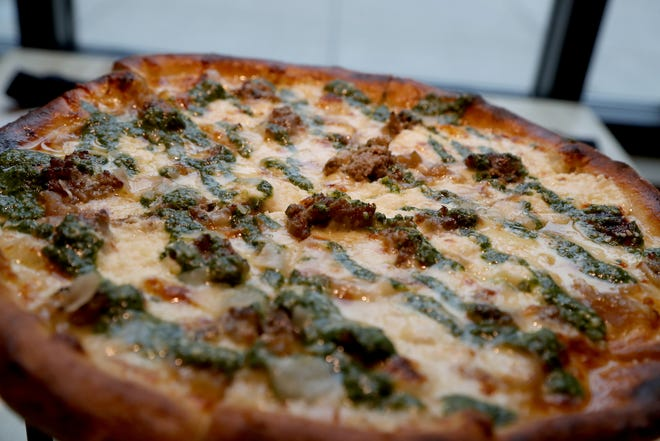 A Starry Hope pizza that contains homemade meatballs, caramelized onions, ricotta, mozzarella and pesto cooks in the oven at Mootz Pizzeria and Bar on Wednesday, January 9, 2019.
