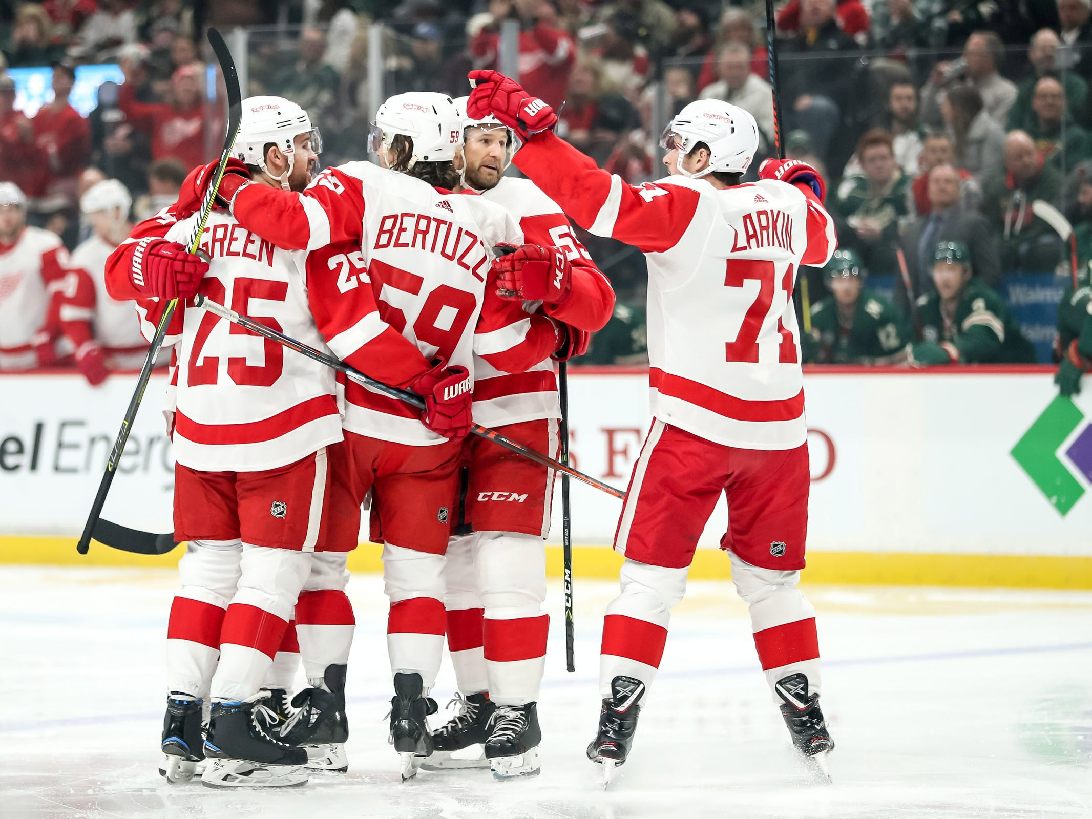Detroit Red Wings forward Tyler Bertuzzi celebrates his goal with teammates during the first period against the Minnesota Wild at Xcel Energy Center, Saturday, Jan. 12, 2019, in St. Paul, Minn.