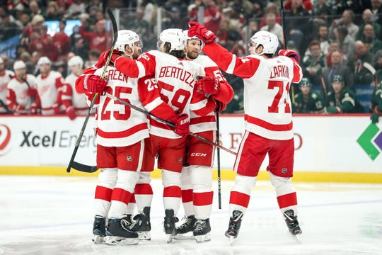 Red Wings forward Tyler Bertuzzi celebrates his goal with teammates during the first period against the Wild at Xcel Energy Center, Saturday, in St. Paul, Minn.