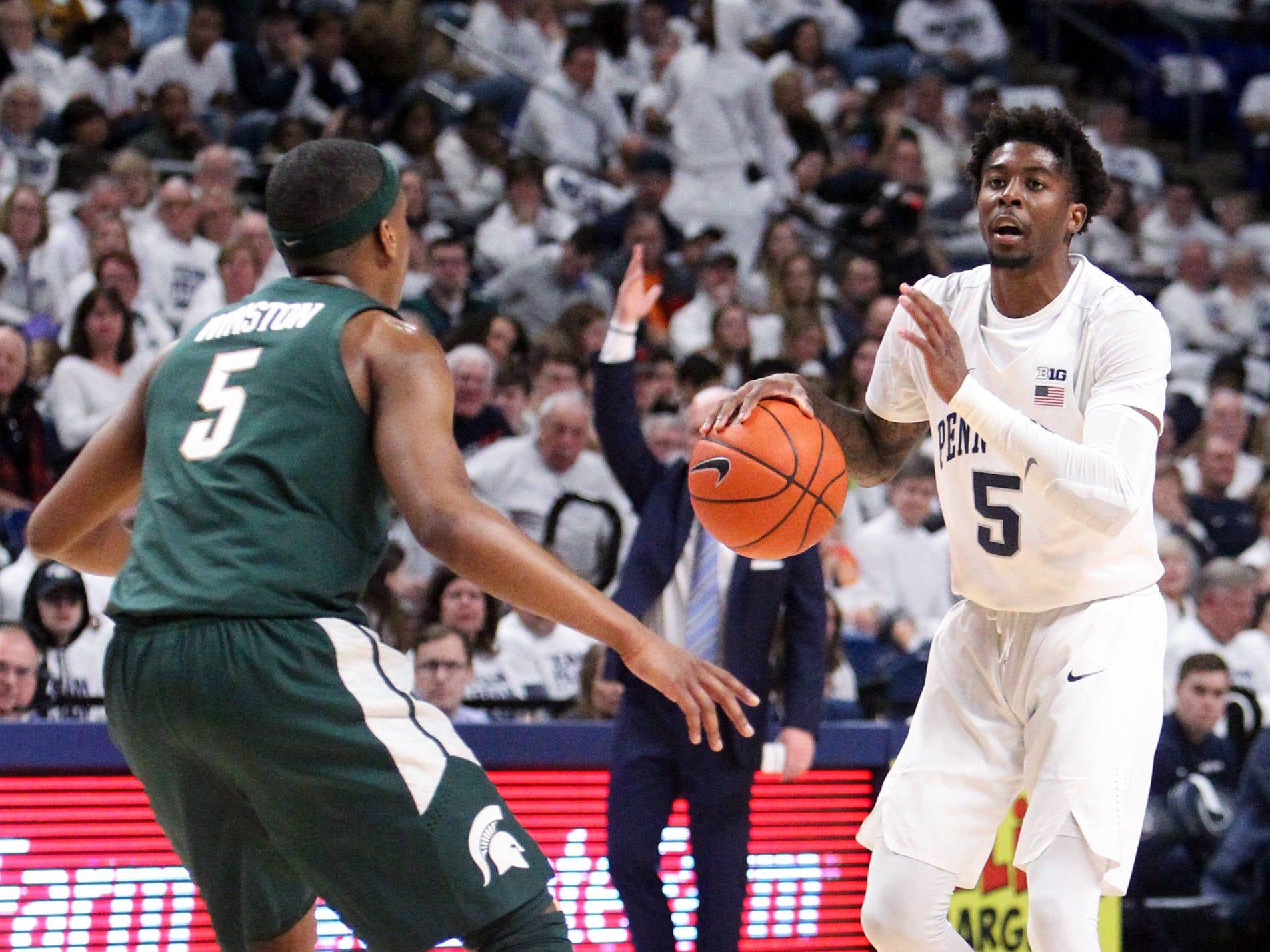 Penn State guard Jamari Wheeler dribbles against Michigan State guard Cassius Winston in the first half at Bryce Jordan Center, Sunday, Jan. 13, 2019.