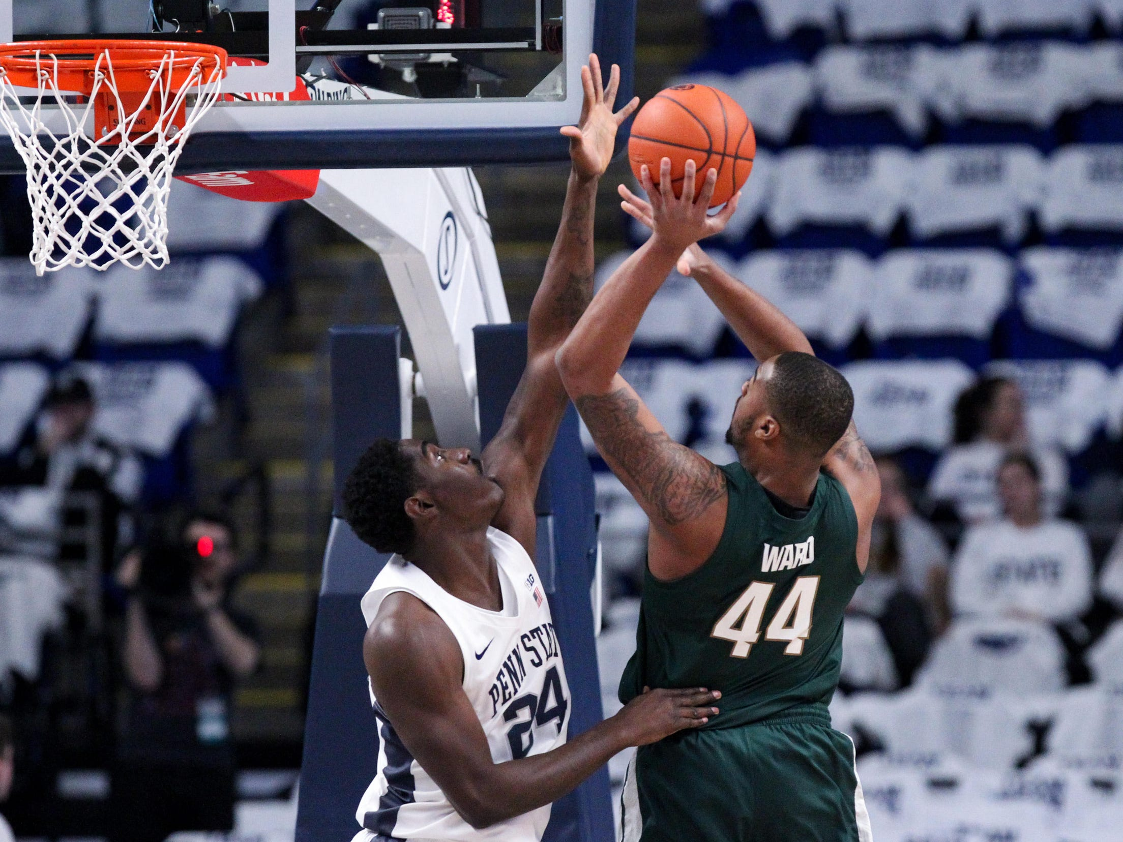 Penn State forward Mike Watkins defends as Michigan State forward Nick Ward shoots during the first half at Bryce Jordan Center, Jan. 13, 2019 in University Park, Pa.