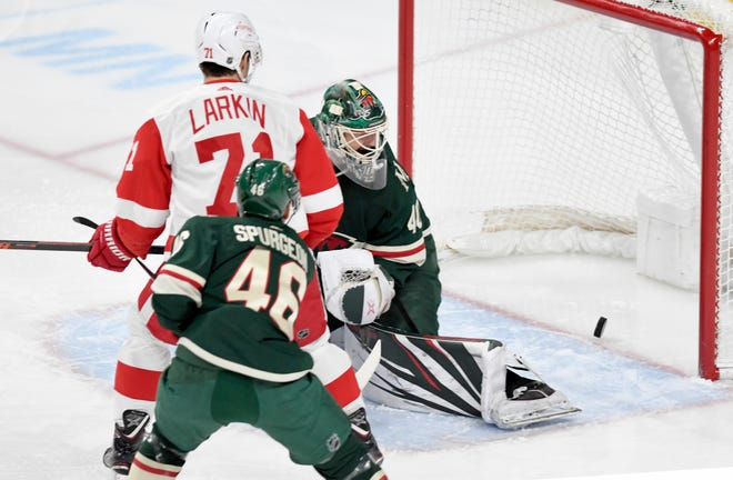 Minnesota Wild goalie Devan Dubnyk, Detroit Red Wings' Dylan Larkin (71) and Wild's Jared Spurgeon watch the goal of the Wings' Gustav Nyquist in the first period Saturday, Jan. 12, 2019, in St. Paul, Minn.