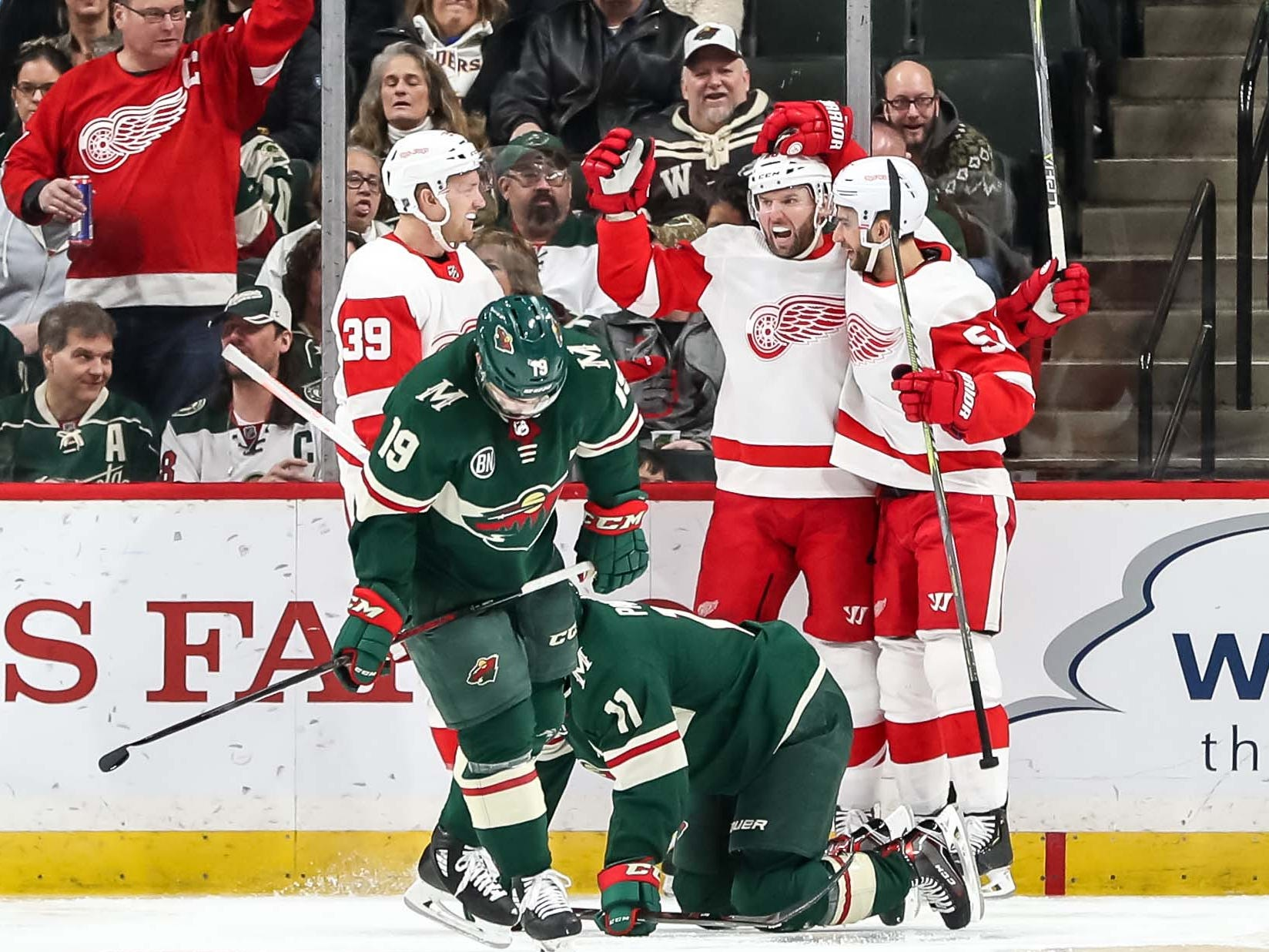 Detroit Red Wings forward Thomas Vanek, center, celebrates his goal with teammates during the second period against the Minnesota Wild, Jan. 12, 2019 in Saint Paul, Minn.
