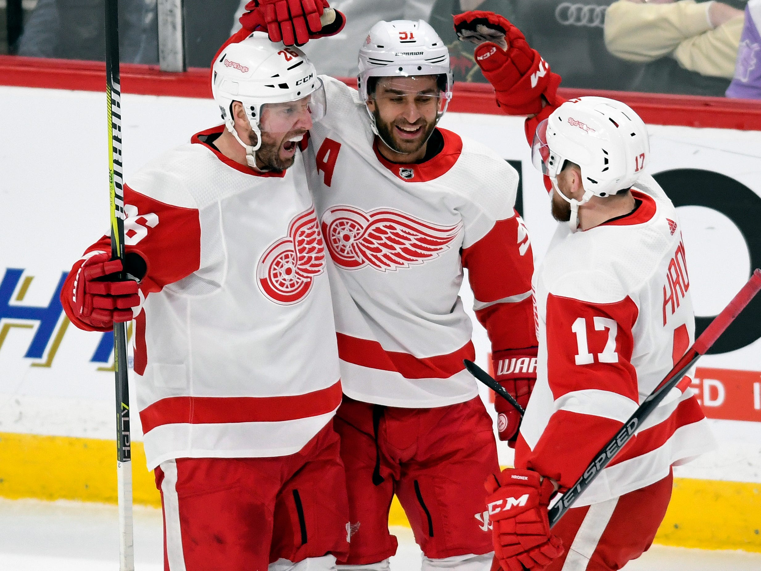 Detroit Red Wings' Frans Nielsen, center, of Denmark, and Filip Hronek (17), of the Czech Republic, congratulate Thomas Vanek, left, of Austria, after he scored a goal against the Minnesota Wild during the second period of an NHL hockey game Saturday, Jan. 12, 2019, in St. Paul, Minn. (AP Photo/Tom Olmscheid)