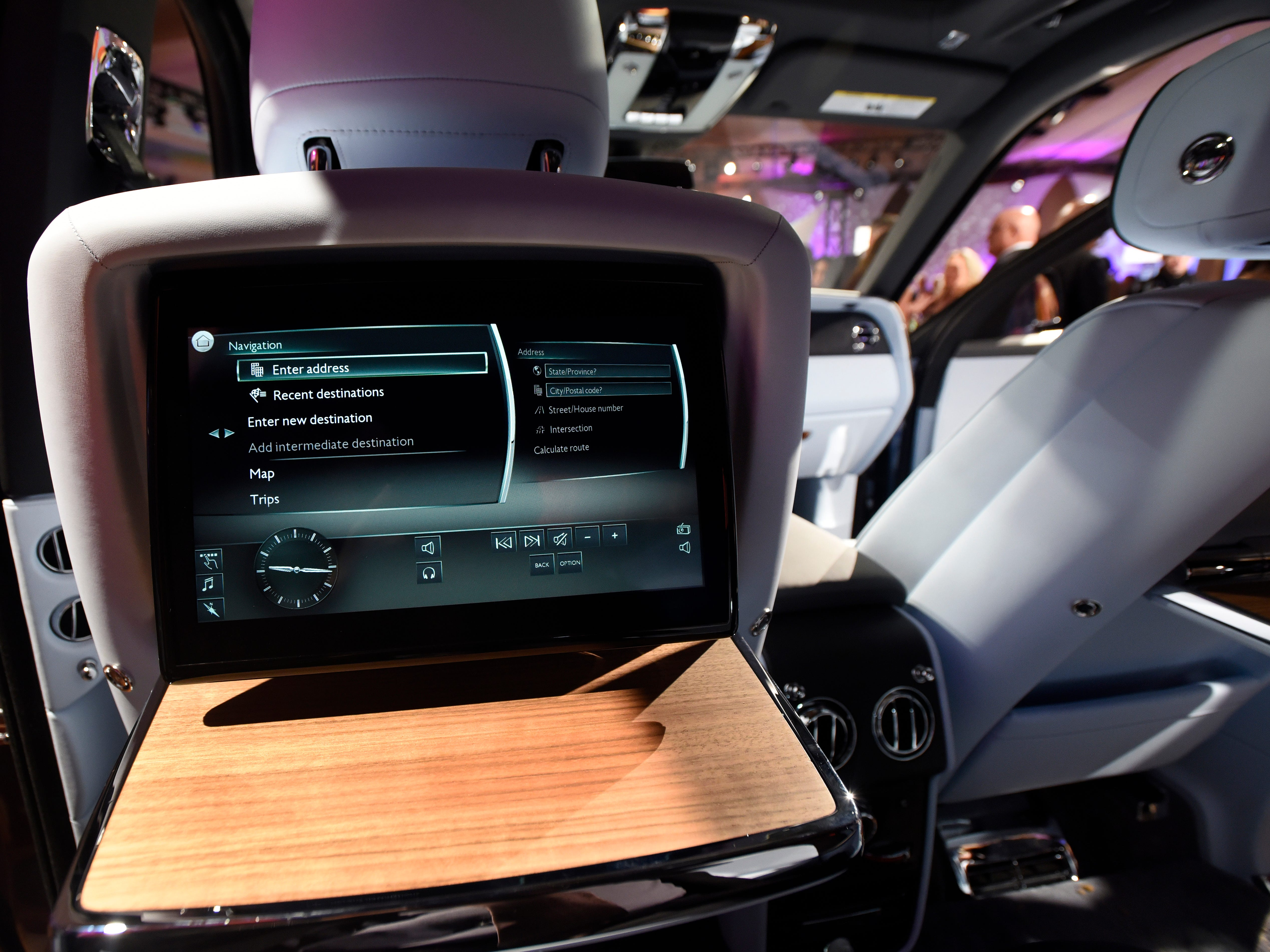 The seat back of the Rolls-Royce Cullinan SUV has a tray table and an infotainment dashboard accessible to passengers .