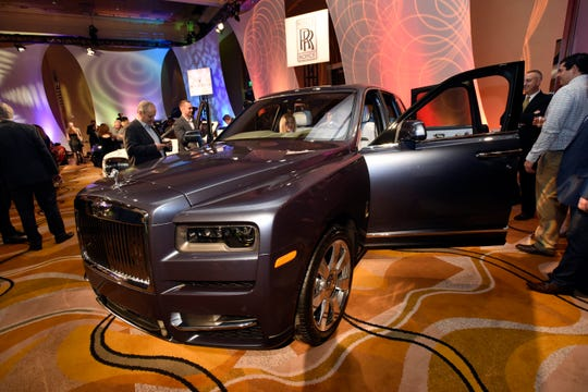Visitors look over the Rolls-Royce Cullinan, the first ever luxury SUV for Rolls Royce.