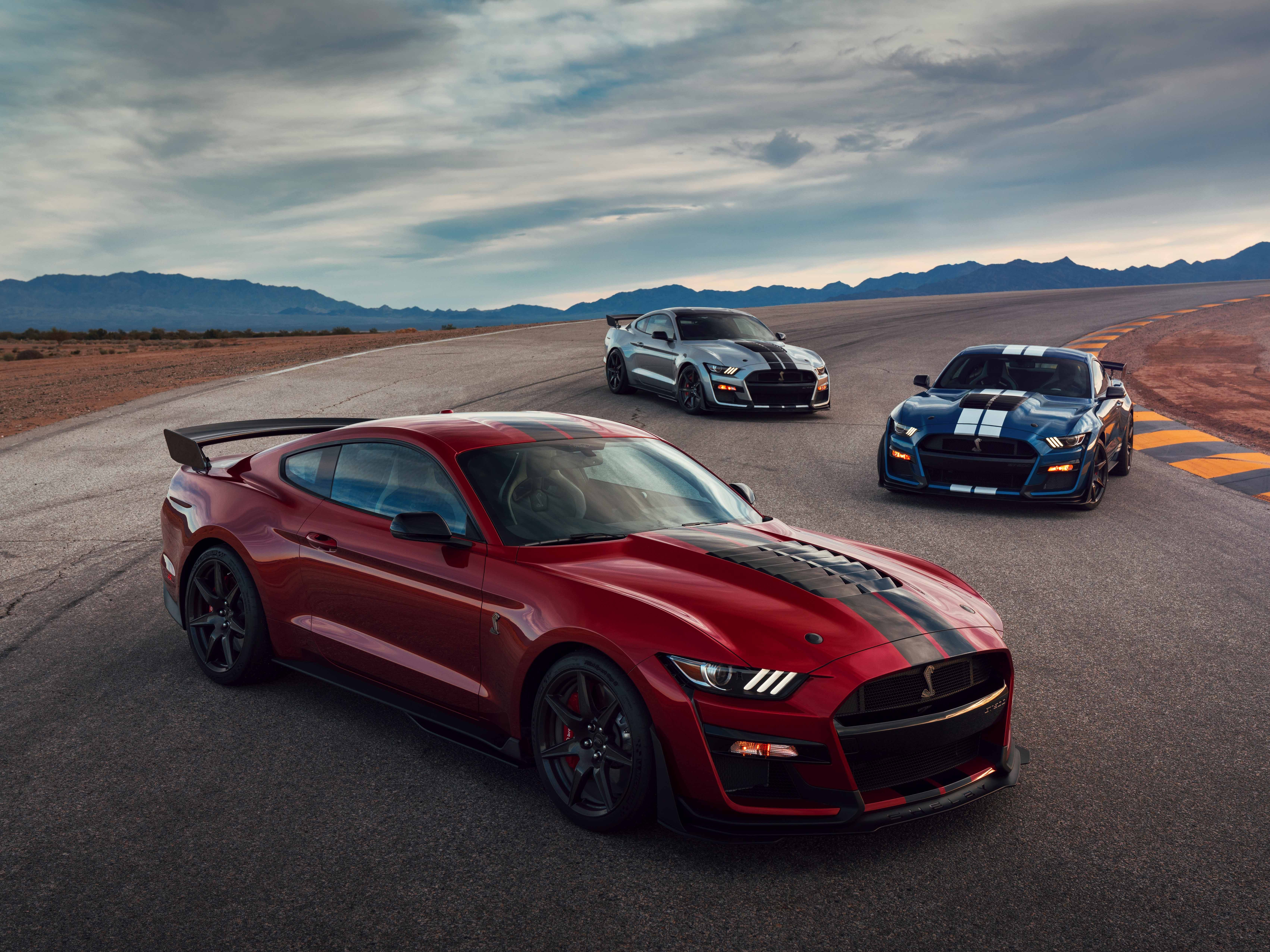 Three Mustang FT500s are seen on a track.