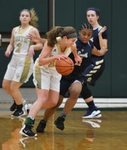 Evelyn Zacharias (foreground) and Grosse Pointe North are No. 10 this week in David Goricki's Super 20 rankings. Grosse Pointe North also is the top-ranked team in the Metro Detroit East region.