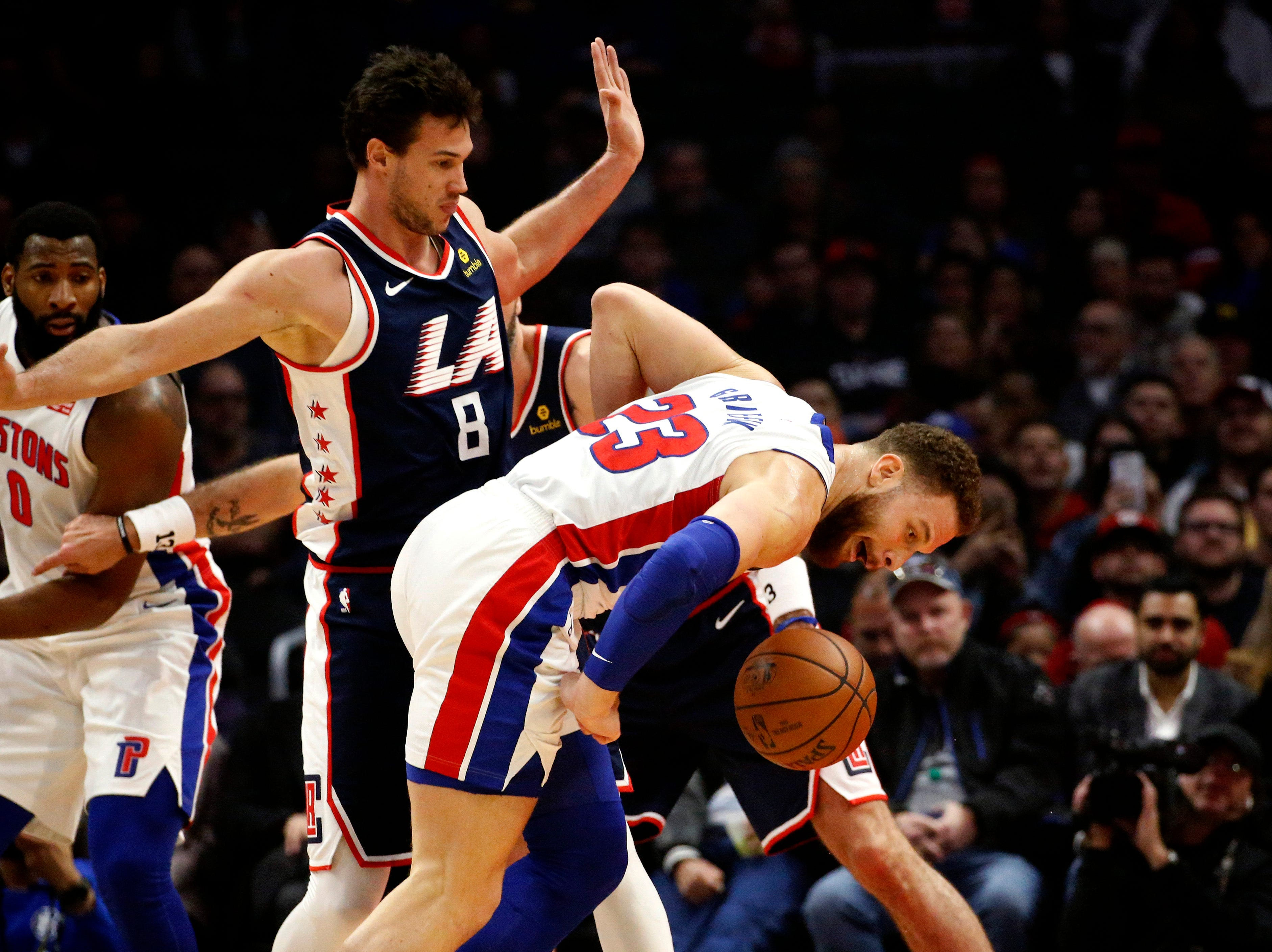 Detroit Pistons' Blake Griffin, right, watches the ball while defended by Los Angeles Clippers' Danilo Gallinari during the first half.