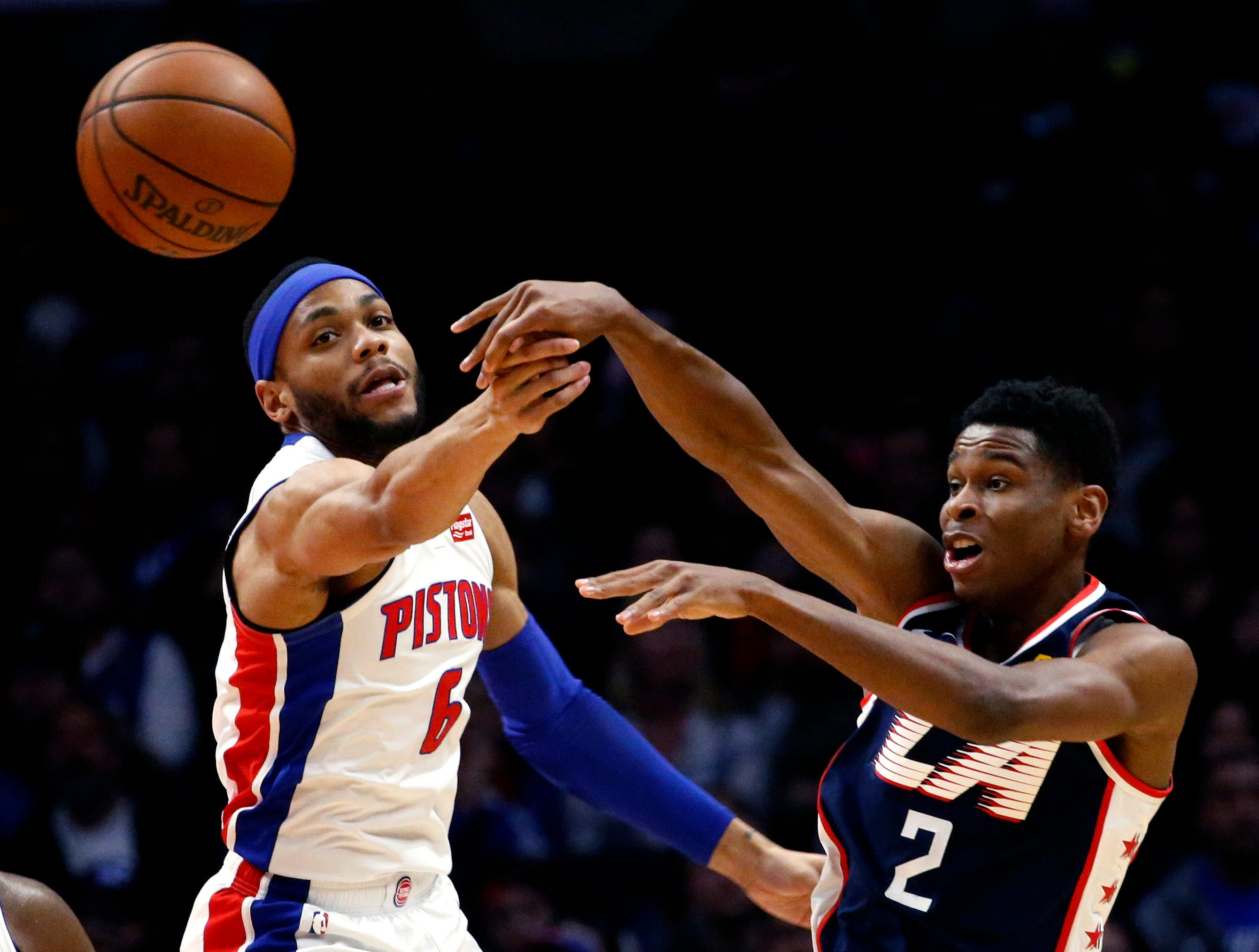 Los Angeles Clippers' Shai Gilgeous-Alexander, right, passes the ball away from Detroit Pistons' Bruce Brown during the second half.