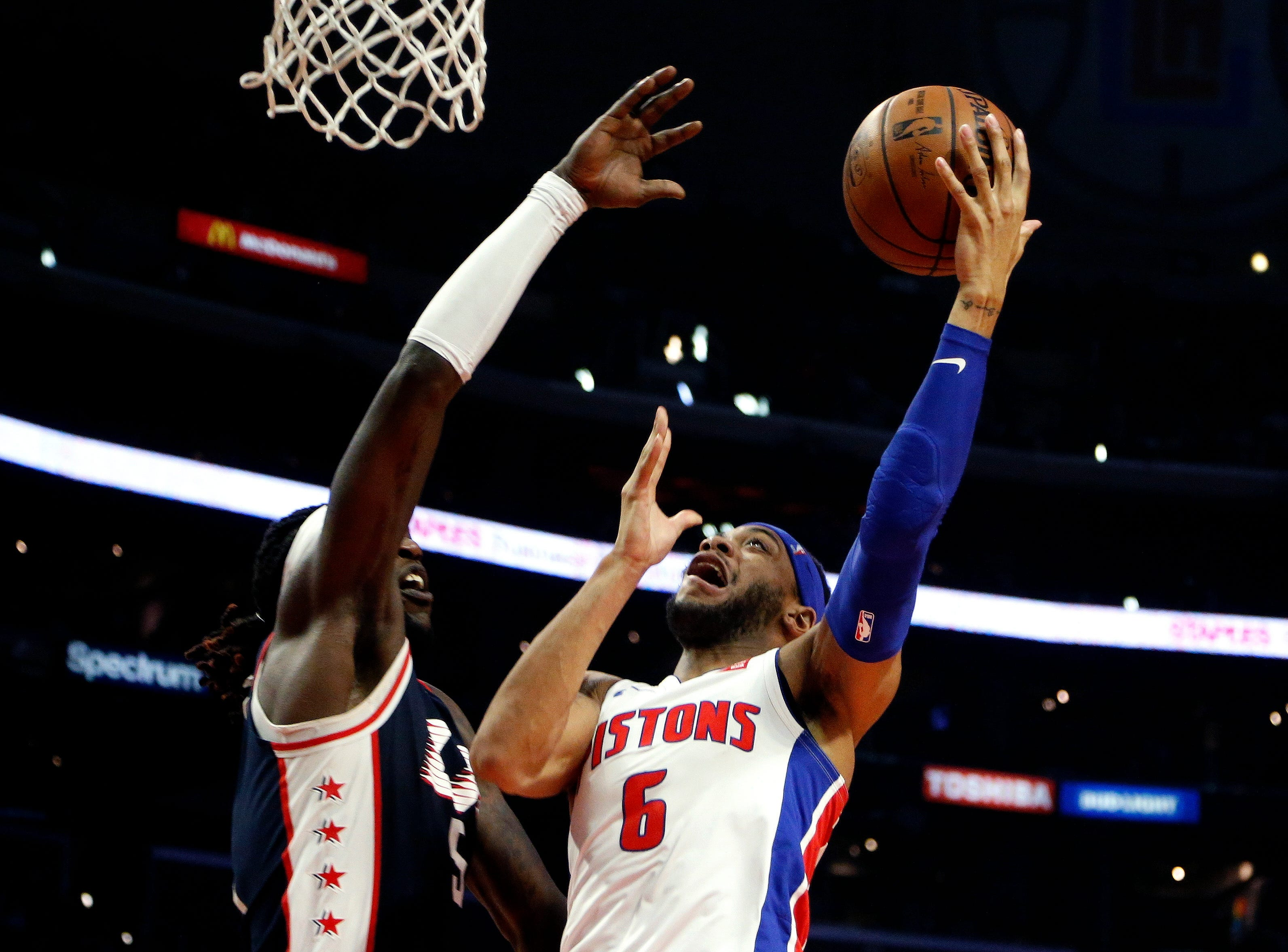 Detroit Pistons' Bruce Brown, right, goes to basket while defended by Los Angeles Clippers' Montrezl Harrell during the second half.