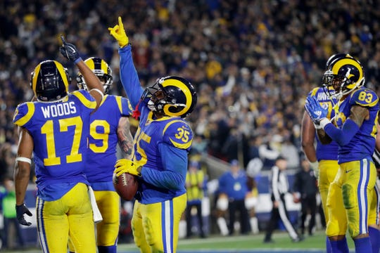 Los Angeles Rams running back C.J. Anderson celebrates after scoring against the Dallas Cowboys during the second half Saturday.