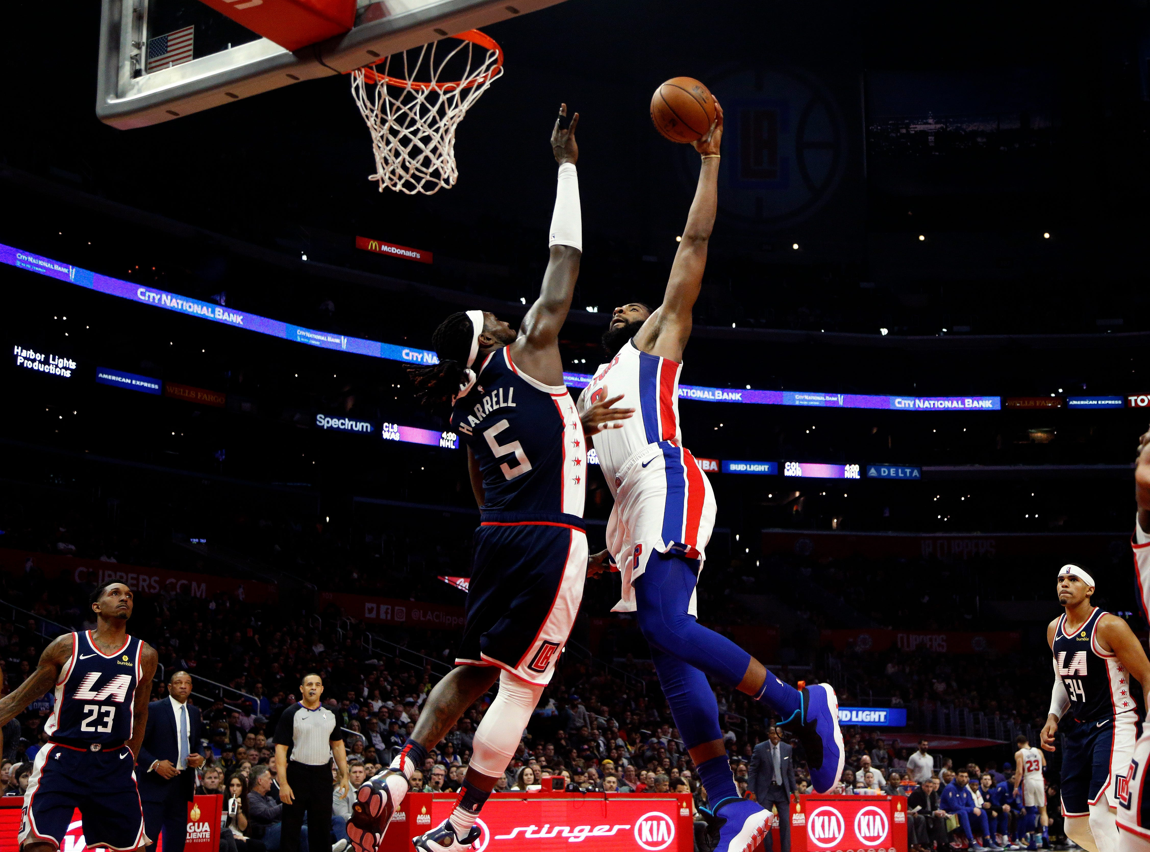 Detroit Pistons' Bruce Brown, center right, goes to basket while defended by Los Angeles Clippers' Montrezl Harrell during the second half.