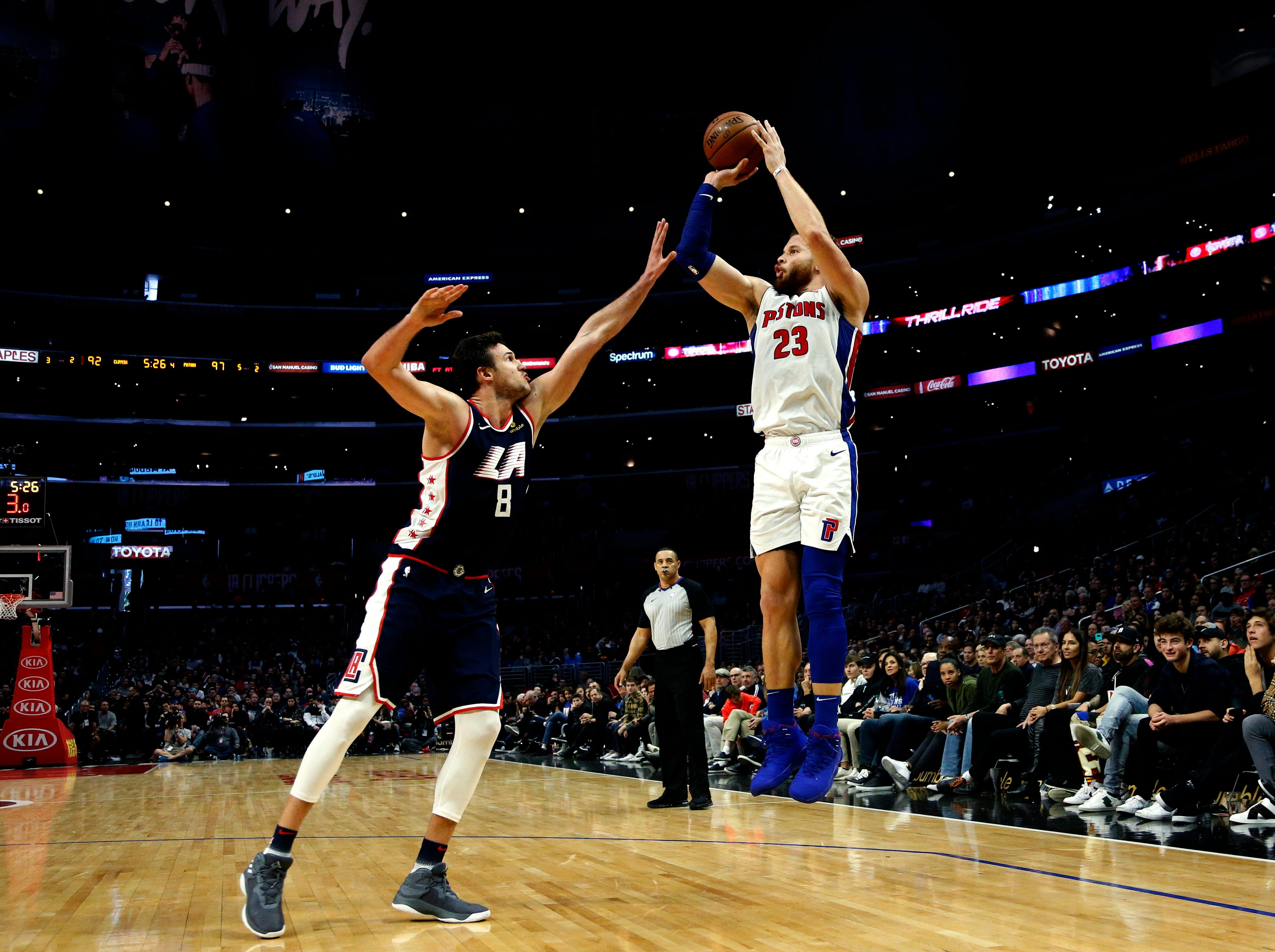 Detroit Pistons' Blake Griffin, right, shoots over Los Angeles Clippers' Danilo Gallinari during the second half.
