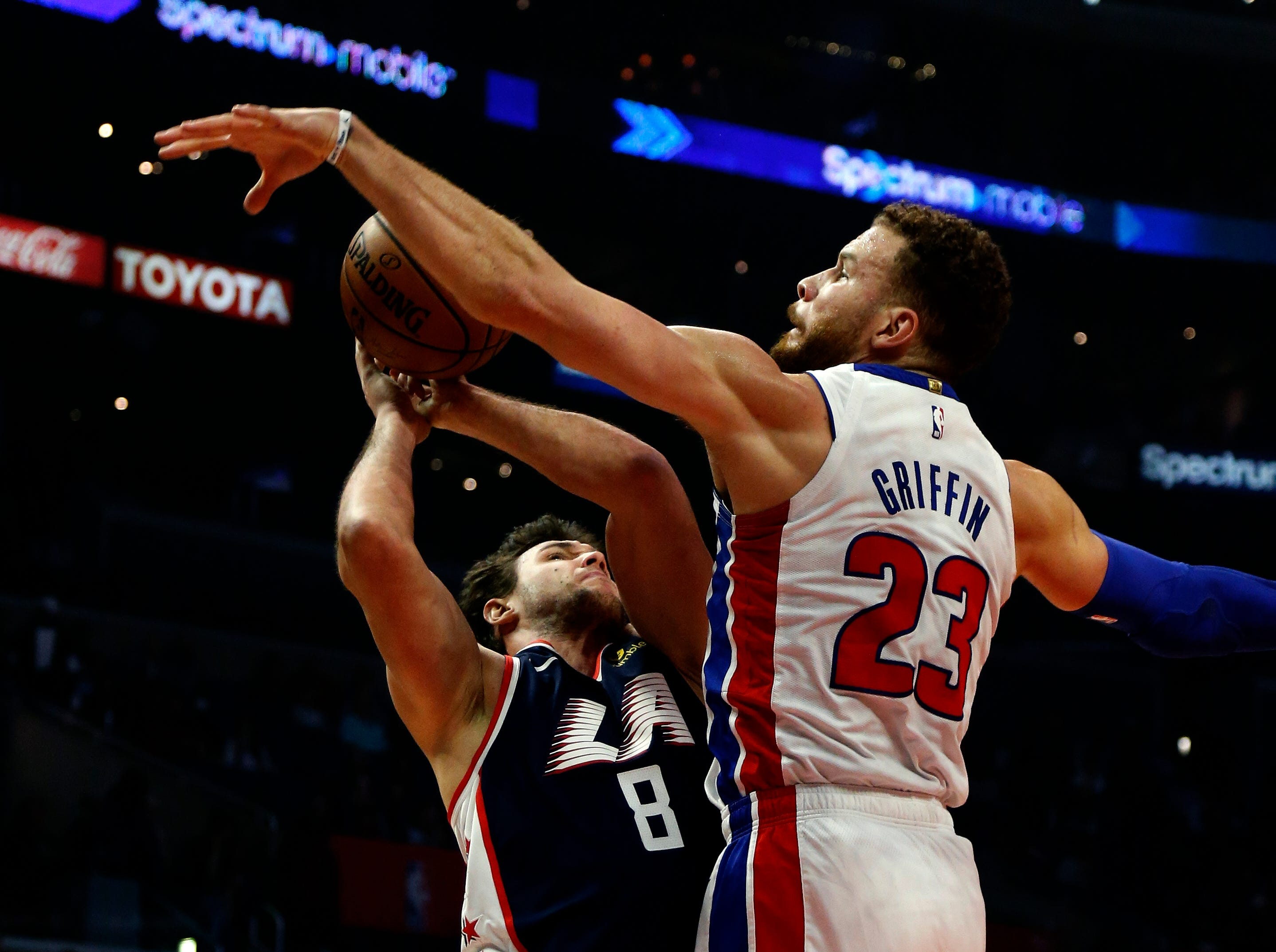 Detroit Pistons' Blake Griffin, right, blocks a shot by Los Angeles Clippers' Danilo Gallinari during the first half.