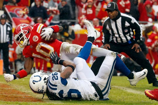 Kansas City Chiefs wide receiver Tyreek Hill (10) scores a touchdown past Indianapolis Colts safety Clayton Geathers (26) during the first half Saturday. The Chiefs won 31-13 and will play the winner of Sunday's L.A. Chargers and New Patriots game in the AFC title game next weekend.