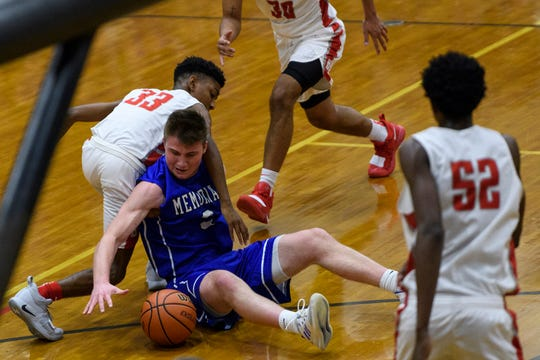 Bosse's Matt Wagner (33) and Memorial's Branson Combs (3) fight for possession of a loose ball in the first quarter of the SIAC tournament championship at Reitz High School in Evansville, Ind., Saturday, Jan. 12, 2019.