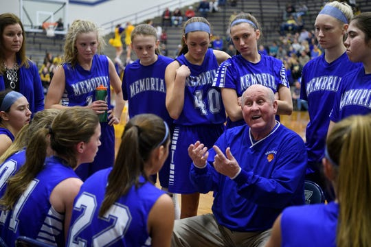 Memorial Head Coach Bruce Dockery talks to his team during a timeout in the first quarter of the SIAC championship game against the Castle Knights at Reitz High School in Evansville, Ind., Saturday, Jan. 12, 2019.