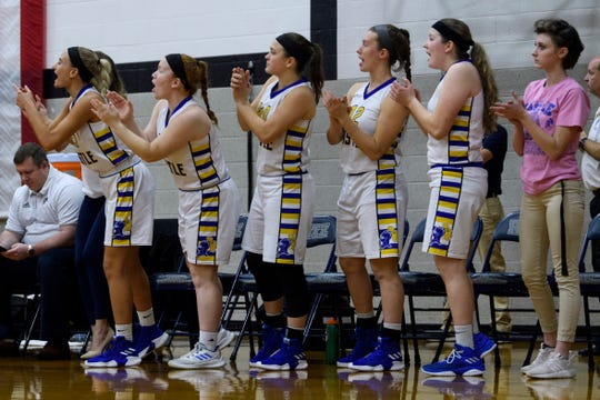 The Castle Knights cheer on their teammates during the SIAC championship match against the Memorial Tigers at Reitz High School in Evansville, Ind., Saturday, Jan. 12, 2019.
