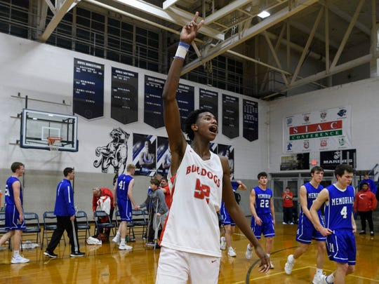 Bosse's Kiyron Powell (52) celebrates his team's 82-61 victory over the Memorial Tigers in the SIAC tournament championship at Reitz High School in Evansville, Ind., Saturday, Jan. 12, 2019. The Bulldogs became SIAC tournament champions for the second straight season.