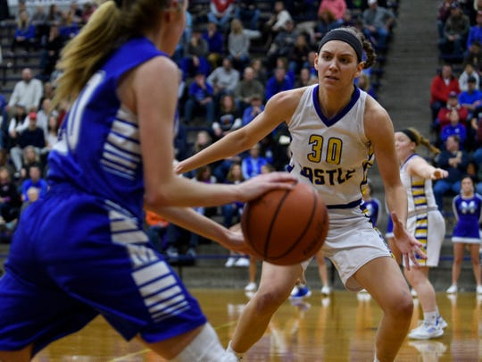 Castle's Jessica Nunge (30) guards Memorial's Ryleigh Anslinger (20) during the SIAC championship match at Reitz High School in Evansville, Ind., Saturday, Jan. 12, 2019. The Knights defeated the Tigers 49-31 to win the SIAC tournament for the second straight season.