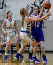 Castle's Natalie Niehaus (32) guards Memorial's Savannah Warren (10) during the fourth quarter of the SIAC championship at Reitz High School in Evansville, Ind., Saturday, Jan. 12, 2019. The Knights defeated the Tigers 49-31 to win the SIAC tournament for the second straight season.