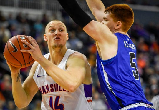 University of Evansville's Dainius Chatkevicius (14) looks to shoot over Indiana State's Bronson Kessinger (5) as the University of Evansville Purple Aces play the Indiana State Sycamores at the Evansville Ford Center Saturday, January 12, 2019.