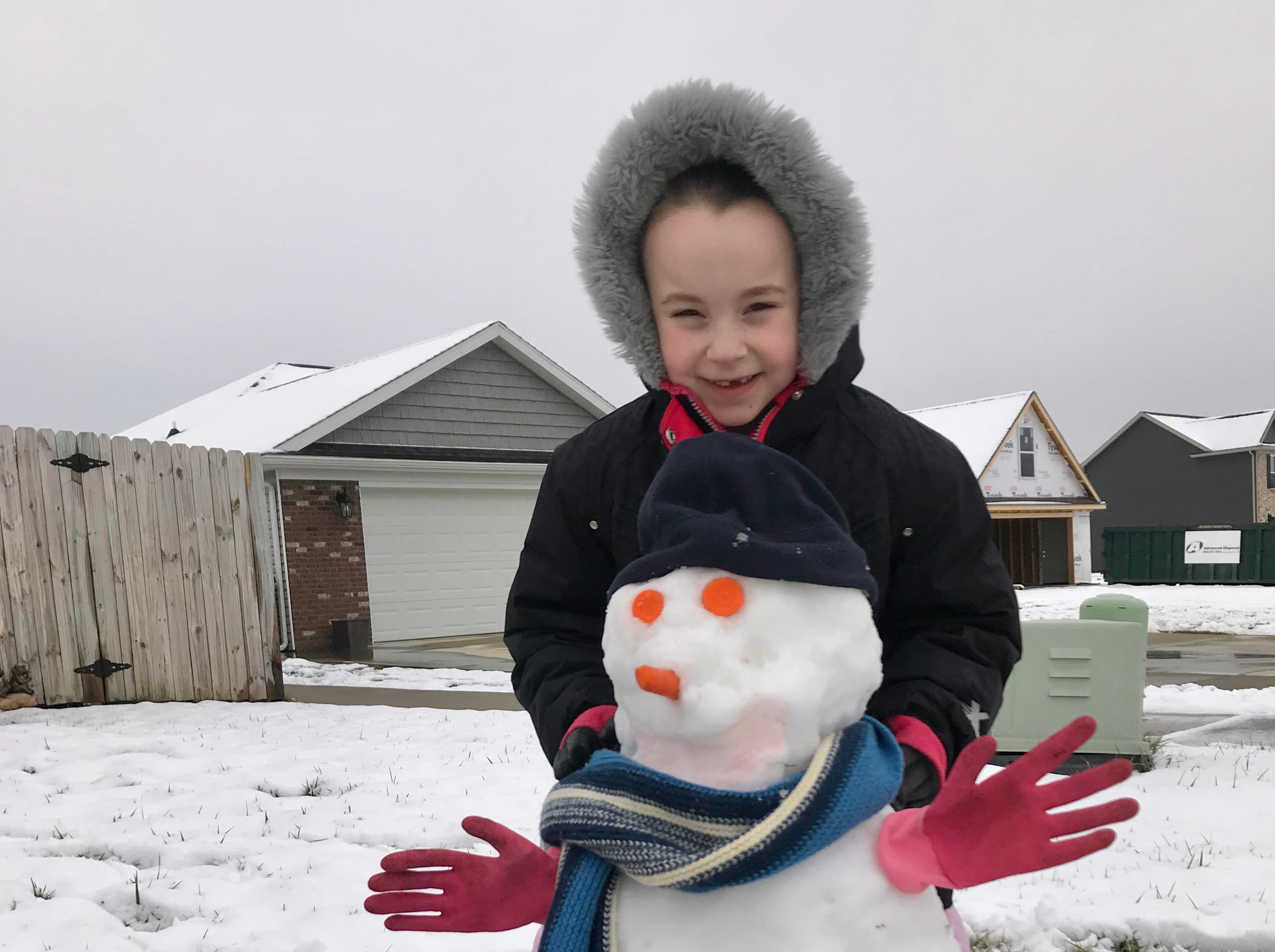 Josie Wilson poses with her snowman at her family's Evansville home.