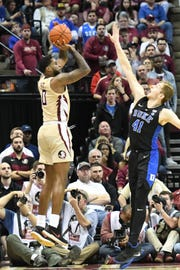 FSU redshirt senior forward Phil Cofer (0) shooting a three pointer in the second half of the FSU game against Duke at the Tucker Center on January 12, 2019.