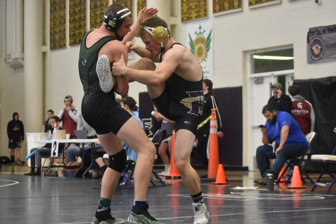 Fossil Ridge High School's Cody Ginther, left, and Fort Collins' Joe Connor, shown competing in the recent Arnold Torgerson Invitational, and wrestlers from all four of the city's Class 5A high schools will be competing in the Front Range League championships Saturday at Poudre High, beginning at 8 a.m.