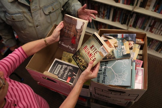 """Some libraries must rely on so-called """"book sales"""" to help boost operating revenue."""
