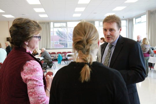 Thomas Moore answers questions during a meet and greet for superintendent finalists recently.