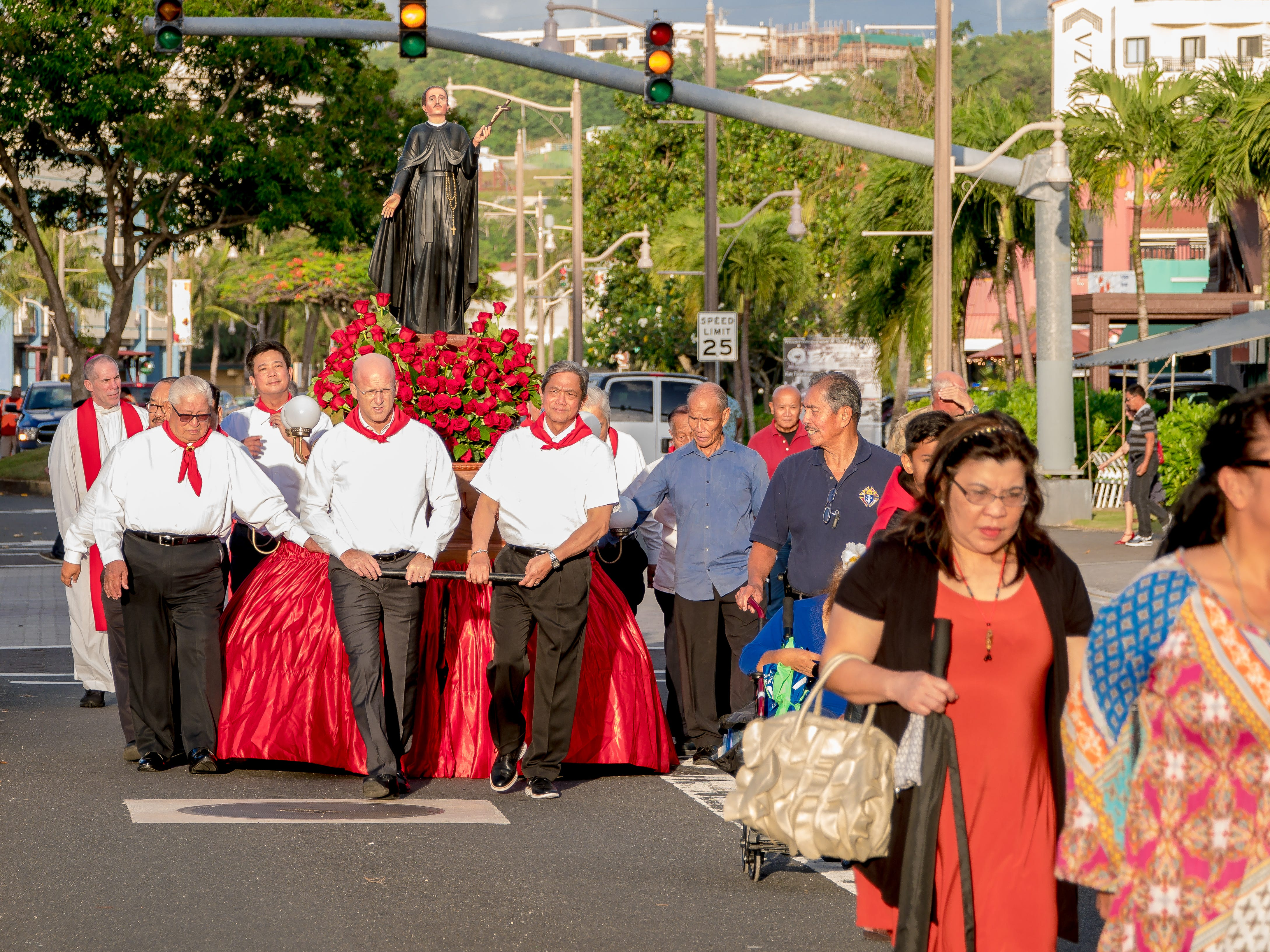 Faithfuls attend the procession of the statue of Blessed Diego Luis de San Vitores during the Celebration of Feast of San Vitores in Tumon on Jan. 12.
