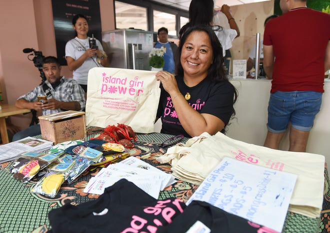 Island Girl Power Program Director Juanita Blaz displays one of her organization's bags in this 2018 file photo. Nonprofit groups have been hit hard by the coronavirus pandemic on Guam.