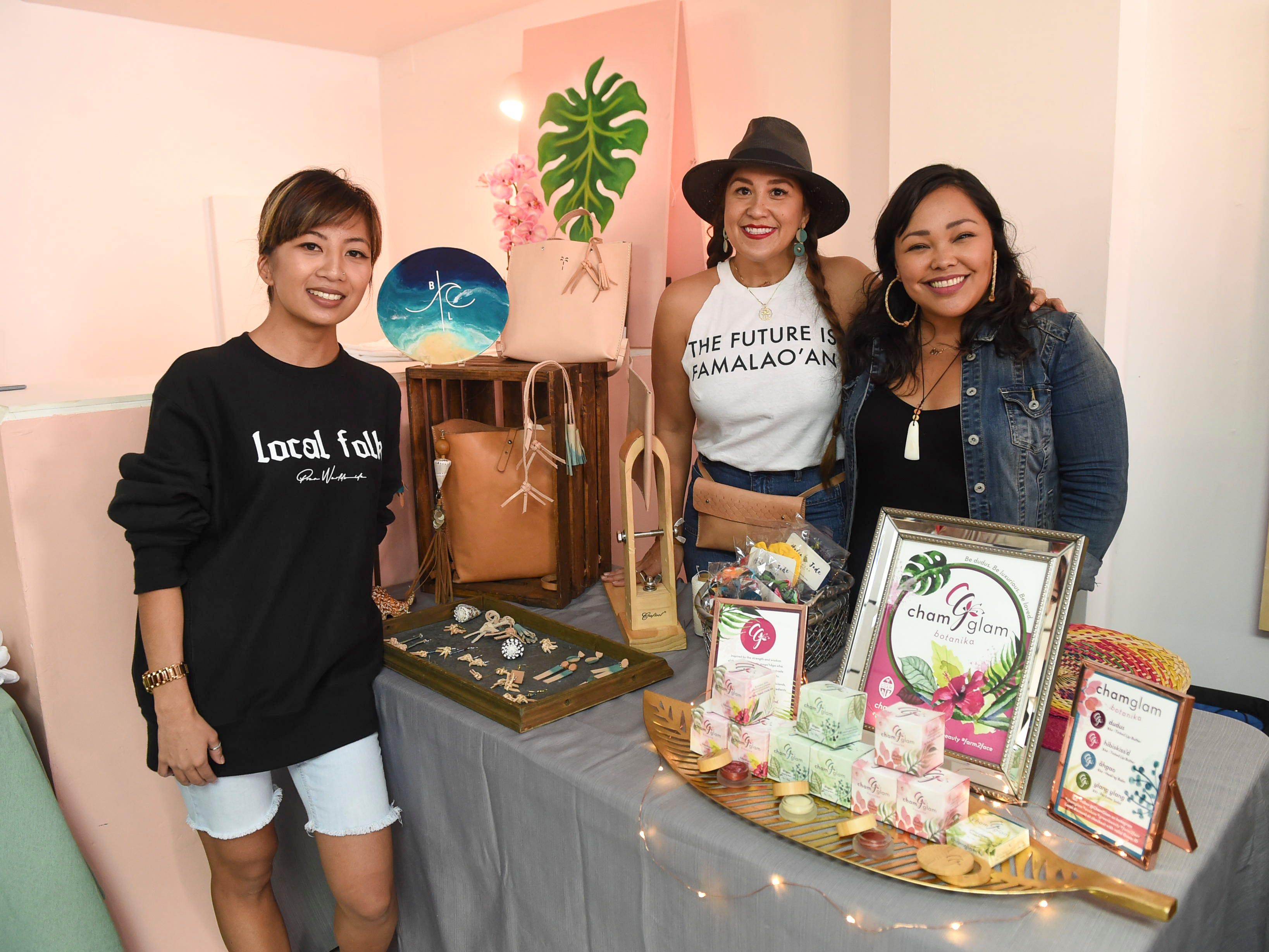 Leslie Sanga, owner of upcoming clothing company, Gacha, left, with Blue Latitude owner Abby Crain, center and ChamGlam Botanika owner Ursula Herrera, during the launch party of women's group, Maga'håga Rising, at Sundays Guam in Tumon, Jan. 13, 2018.