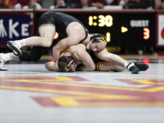Hawkeye wrestlers remain perfect with strong win over Minnesota